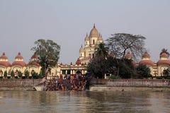Hindu people bathing in the ghat near the Dakshineswar Kali Temple in Kolkata Stock Images