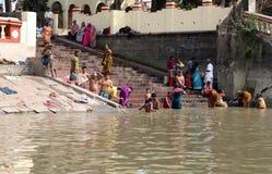 Hindu people bathing in the ghat near the Dakshineswar Kali Temple in Kolkata Royalty Free Stock Photos