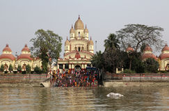 Hindu people bathing in the ghat near the Dakshineswar Kali Temple in Kolkata Royalty Free Stock Image