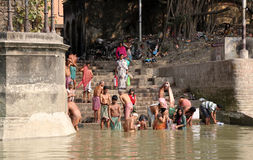 Hindu people bathing in the ghat near the Dakshineswar Kali Temple in Kolkata Royalty Free Stock Photography