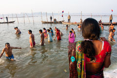 Hindu people bathing in water Royalty Free Stock Images