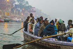 Hindu people in a boat on river Royalty Free Stock Image