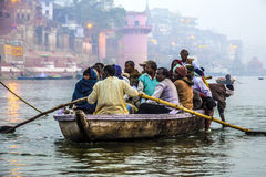 Hindu people in a boat on river Royalty Free Stock Images