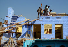 Hindu people building a blue house Royalty Free Stock Photography
