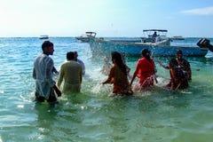 Hindu people celebrating Ganesh. In the Indian Ocean Royalty Free Stock Photo