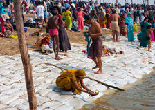 Hindu people praying and bathing Stock Images