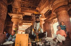 Free Hindu People Sitting Near Nandi Bull After Puja Ritual In Traditional Temple Stock Photos - 157703603