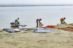 Hindu people wash clothes in the river Ganga in the holy city of Royalty Free Stock Image