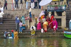 Hindu people wash themselves Stock Photo