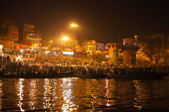 Hindu people watching religious Ganga Aarti ritual Royalty Free Stock Images