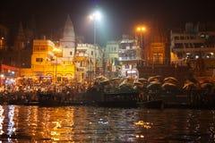 Hindu people watching religious Ganga Aarti ritual Stock Image