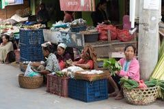 Hindu peoples at the traditional street market, Bali. PENIDA ISLAND, INDONESIA - JUNE 30.2015: woman Hindu at the traditional daily street market, village Royalty Free Stock Image