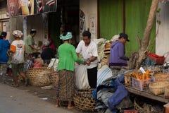 Hindu peoples at the traditional street market, Bali. PENIDA ISLAND, INDONESIA - JUNE 30.2015: woman Hindu at the traditional daily street market, village Royalty Free Stock Photography