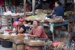 Hindu peoples at the traditional street market, Bali. PENIDA ISLAND, INDONESIA - JUNE 30.2015: woman Hindu at the traditional daily street market, village Stock Photography
