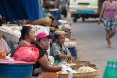 Hindu peoples at the traditional street market, Bali. PENIDA ISLAND, INDONESIA - JUNE 30.2015: woman Hindu at the traditional daily street market, village Stock Photos