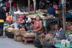 Hindu peoples at the traditional street market, Bali. PENIDA ISLAND, INDONESIA - JUNE 30.2015: woman Hindu at the traditional daily street market, village Royalty Free Stock Images
