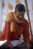 Hindu Pilgrim. A Hindu pilgrim on the Ghats at Varanasi, India Stock Photo