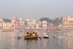 Hindu Pilgrims on Boat in the Ganges River, Varanasi, India Royalty Free Stock Photos