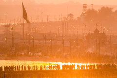 Hindu pilgrims crossing pontoon bridges into the Kumbha Mela campsite, India. Stock Image