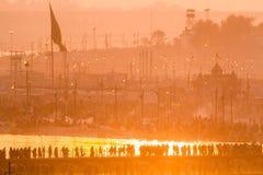Hindu pilgrims crossing pontoon bridges into the Kumbha Mela campsite, India. Stock Image