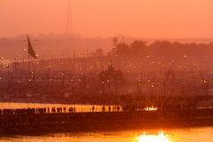Hindu pilgrims crossing pontoon bridges into the Kumbha Mela campsite, India. Stock Photography
