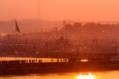 Hindu pilgrims crossing pontoon bridges into the Kumbha Mela campsite, India. Stock Photography