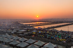 Hindu pilgrims crossing pontoon bridges into the Kumbha Mela campsite, India. Royalty Free Stock Image