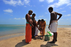 Hindu pilgrims do rituals at Dhanushkodi, Tamil Nadu, India. Stock Photos