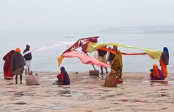 Hindu pilgrims dry their saris in Varanasi Royalty Free Stock Image