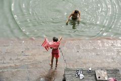 Hindu pilgrims take a holy bath in the river ganges Stock Images