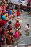 Hindu pilgrims take holy bath in the river ganges Stock Photo