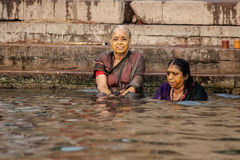 Hindu pilgrims take a holy bath in the river ganges Royalty Free Stock Photos
