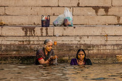 Hindu pilgrims take a holy bath in the river ganges Royalty Free Stock Photo