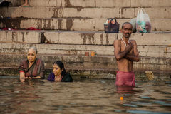Hindu pilgrims take a holy bath in the river ganges Royalty Free Stock Image