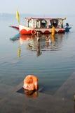 Hindu pilgrims take a holy bath in the river Narmada Stock Photo