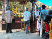 Hindu pilgrims visit a small temple Stock Photos