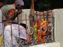 Hindu pilgrims visit a small temple Stock Photography