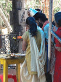 Hindu pilgrims visit a small temple Stock Images