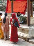 Hindu pilgrims visit a small temple Royalty Free Stock Photo