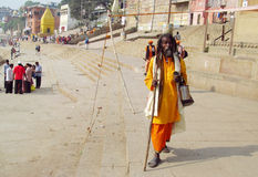 Hindu piligrim man in orange clothes in Varanasi Stock Image