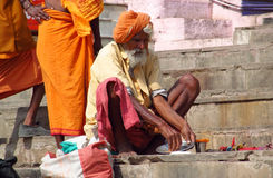 Hindu piligrim man in orange clothes in Varanasi Royalty Free Stock Photo