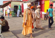 Hindu piligrims in orange clothes in Varanasi Stock Image