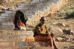A hindu priest and a beggar woman Stock Image
