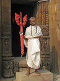 Hindu priest with Krishna simbol. Hindu priest with Krishna fork at the Krishna temple in Bhubaneswar, Orissa state, India. The religion tension in India is a Stock Photo