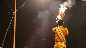 Hindu priest performing with fire at Ganga Aarti ritual in Varanasi. VARANASI, INDIA - 20 FEBRUARY 2015: Hindu priest performing with fire at Ganga Aarti ritual stock footage