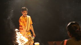 Hindu priest performing with fire at Ganga Aarti ritual in Varanasi. VARANASI, INDIA - 20 FEBRUARY 2015: Hindu priest performing with fire at Ganga Aarti ritual stock video