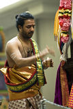 Hindu priest performs the pooja. For the Hindu devotees during the chariot festival at Richmomd Hill Temple Stock Photos