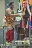 Hindu priest performs the pooja. For the Hindu devotees during the chariot festival at Richmomd Hill Temple Stock Photo