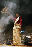 Hindu priest during religious Ganga Aarti ceremony Stock Photos