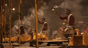Hindu priests offering prayers by Ganges Royalty Free Stock Image